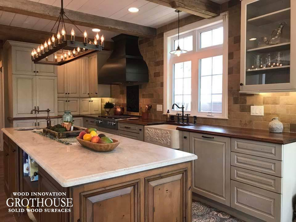 Perimeter walnut wood counters with a butcher block attached to the island in Mapleton, Illinois