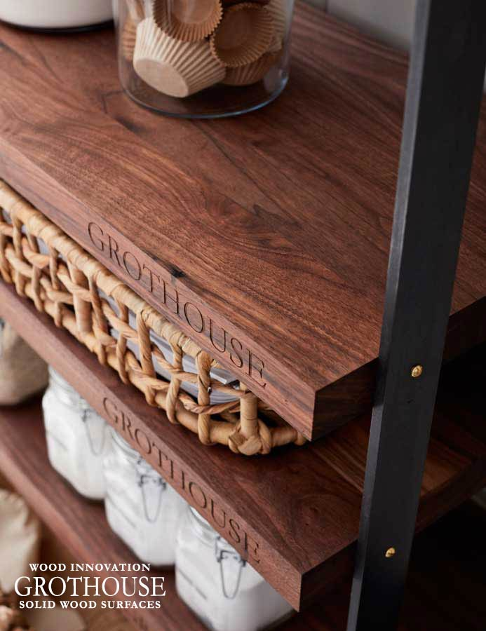 Custom Walnut Wood Shelving with Engraving on the Front Edge for an Open Kitchen Pantry