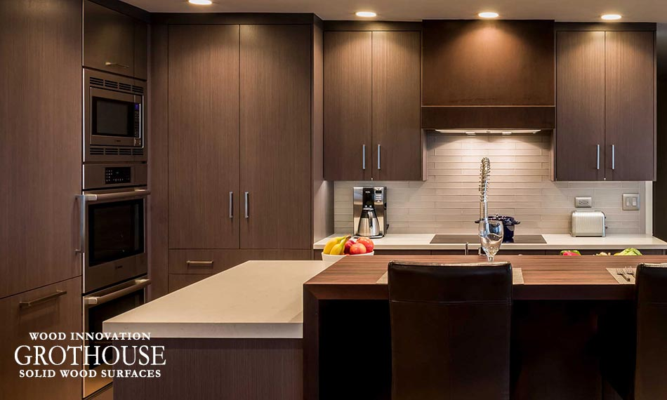 Peruvian Walnut Kitchen Bar Top with Complimentary Beige Countertops for a Lake House Kitchen