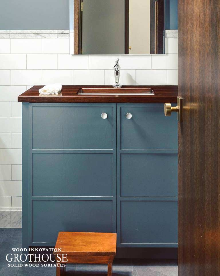 Peruvian Walnut Wood Vanity Top for a powder room design with blue cabinetry in Birmingham, Michigan