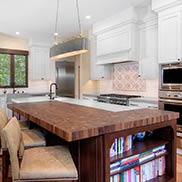 Walnut wood kitchen island butcher block for a transitional kitchen design with a Mediterranean twist in California
