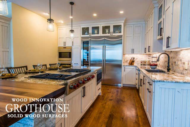 Traditional kitchen design with a walnut all heartwood kitchen countertop with two stools for convenient seating