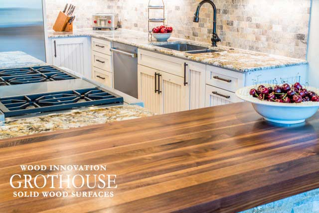 Walnut all heartwood kitchen countertop with stool seating for a traditional kitchen design in Breckenridge Colorado