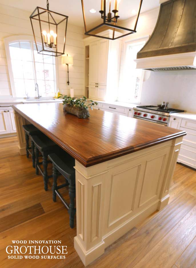 Hand Planed Walnut Wood Counter for a large kitchen island with white cabinetry in Harahan, Louisiana