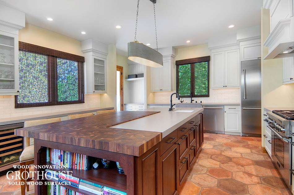 Custom walnut wood butcher block made for a kitchen island design in a transitional kitchen in california