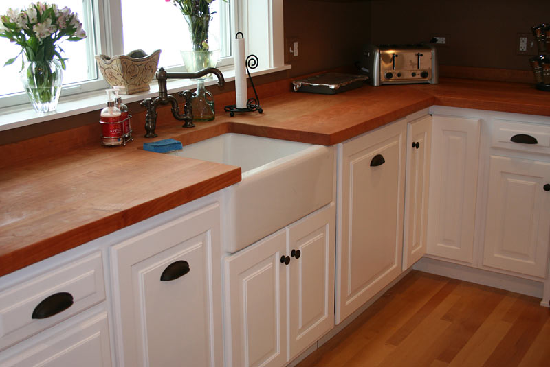 kitchen countertops provide a functional warm work area in the kitchen ...