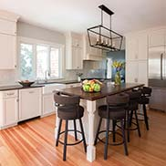Walnut Wood Island Counter designed by The Cabinetry Kitchen & Bath Studio in Hingham, Massachusetts