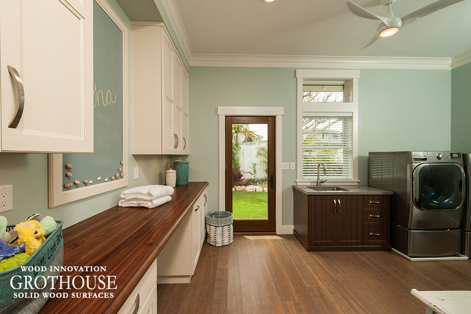 Walnut with Sapwood laundry room countertop with white cabinetry and light blue walls in Honolulu, Hawaii