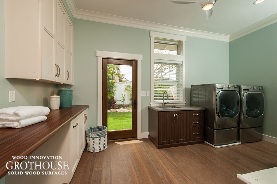 Walnut with sapwood laundry room countertop with white cabinetry designed by Archipelago Hawaii in Honalulu, Hawaii