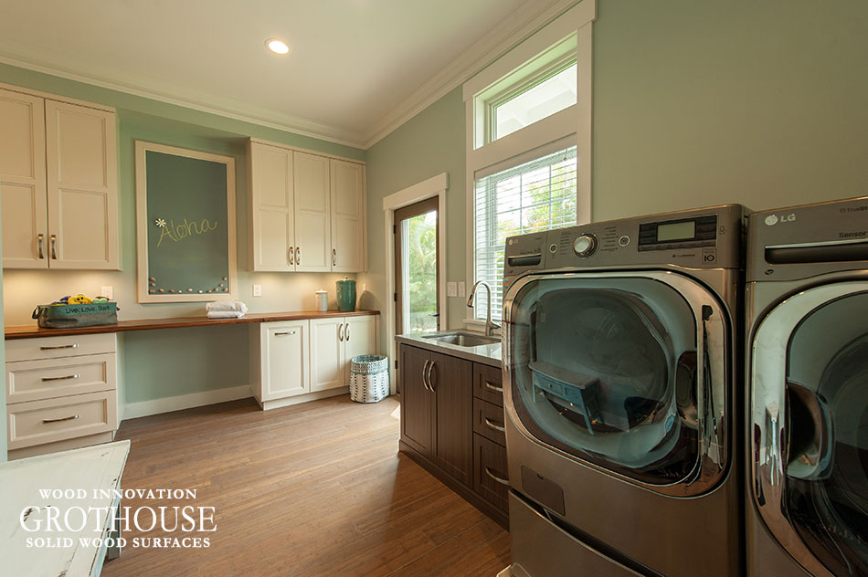 Walnut with sapwood laundry room countertop with a chalkboard and surrounding white cabinetry for organized storage
