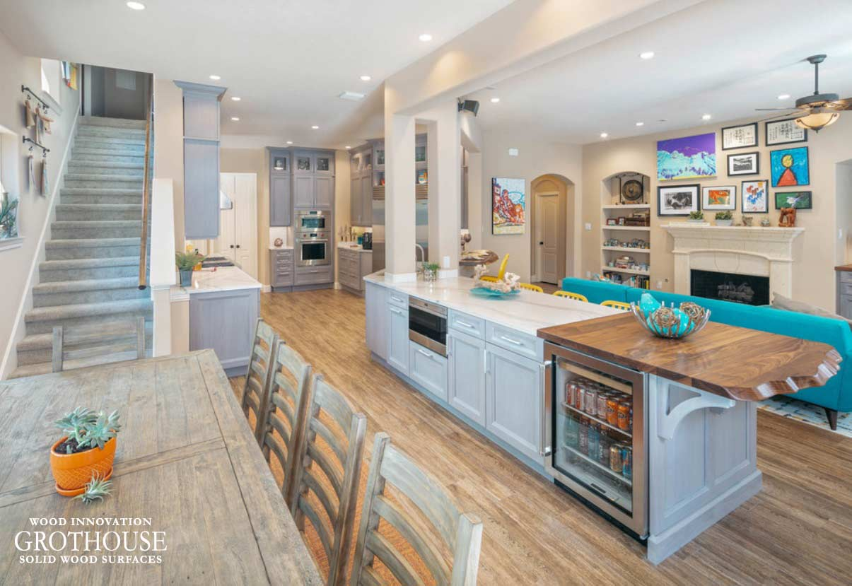Transitional Kitchen Design with a Walnut with Sapwood Faux Live Edge Island Top in Friendswood, Texas