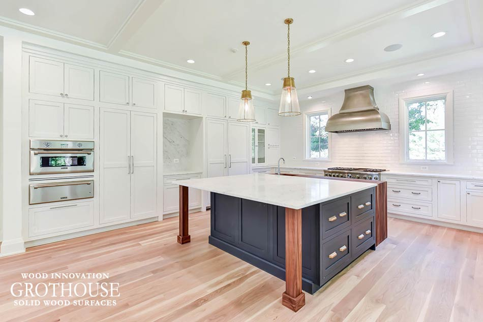 Traditional Kitchen with White Perimeter and Blue Island Cabinets and a Walnut Waterfall Countertop