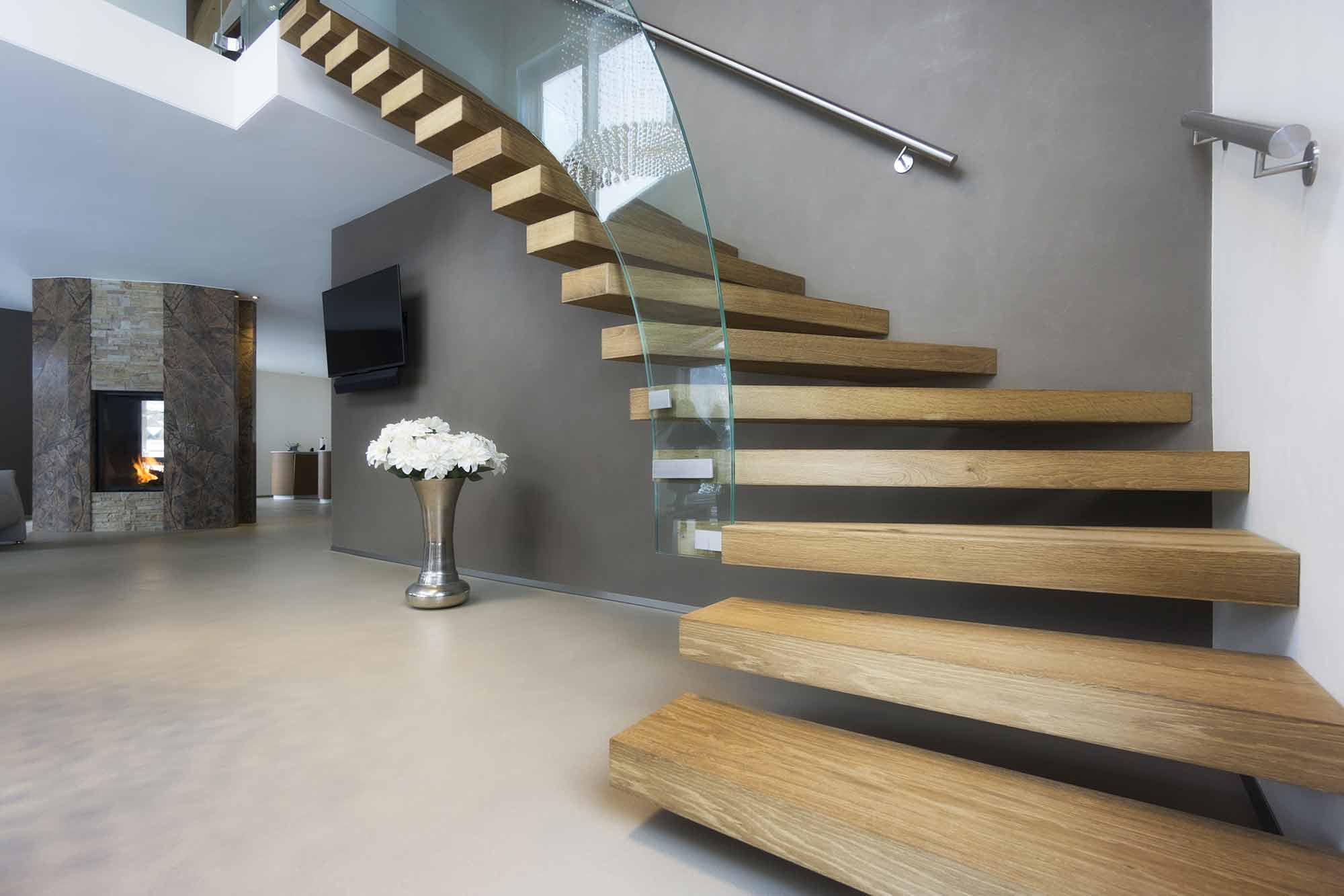 Custom Wood Stair Treads Made from a Light Wood with Glass Railing for a Contemporary Home
