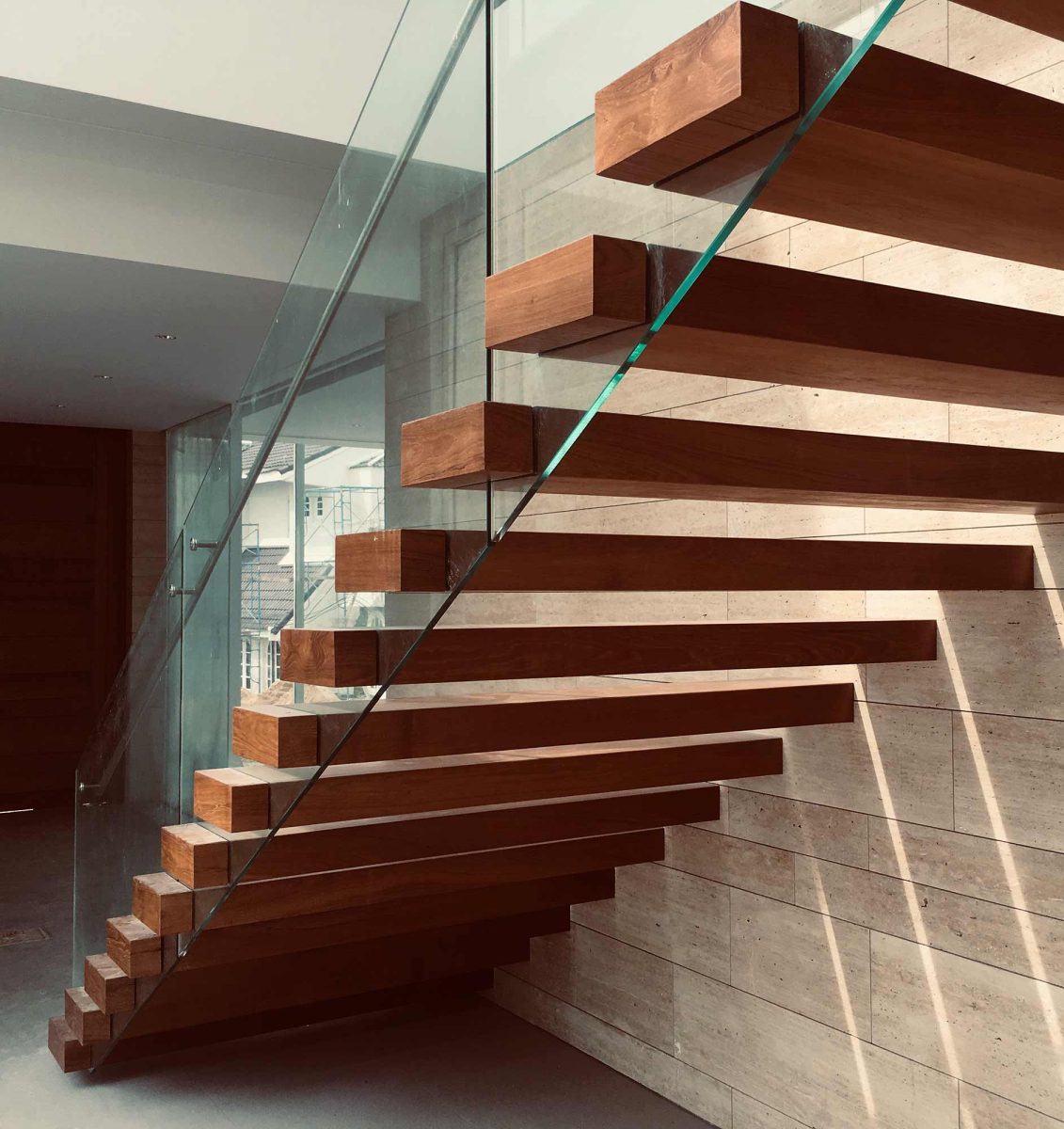 Floating Custom Wood Stair Treads Manufactured in Pennsylvania for a Large Stairway with a Glass Railing