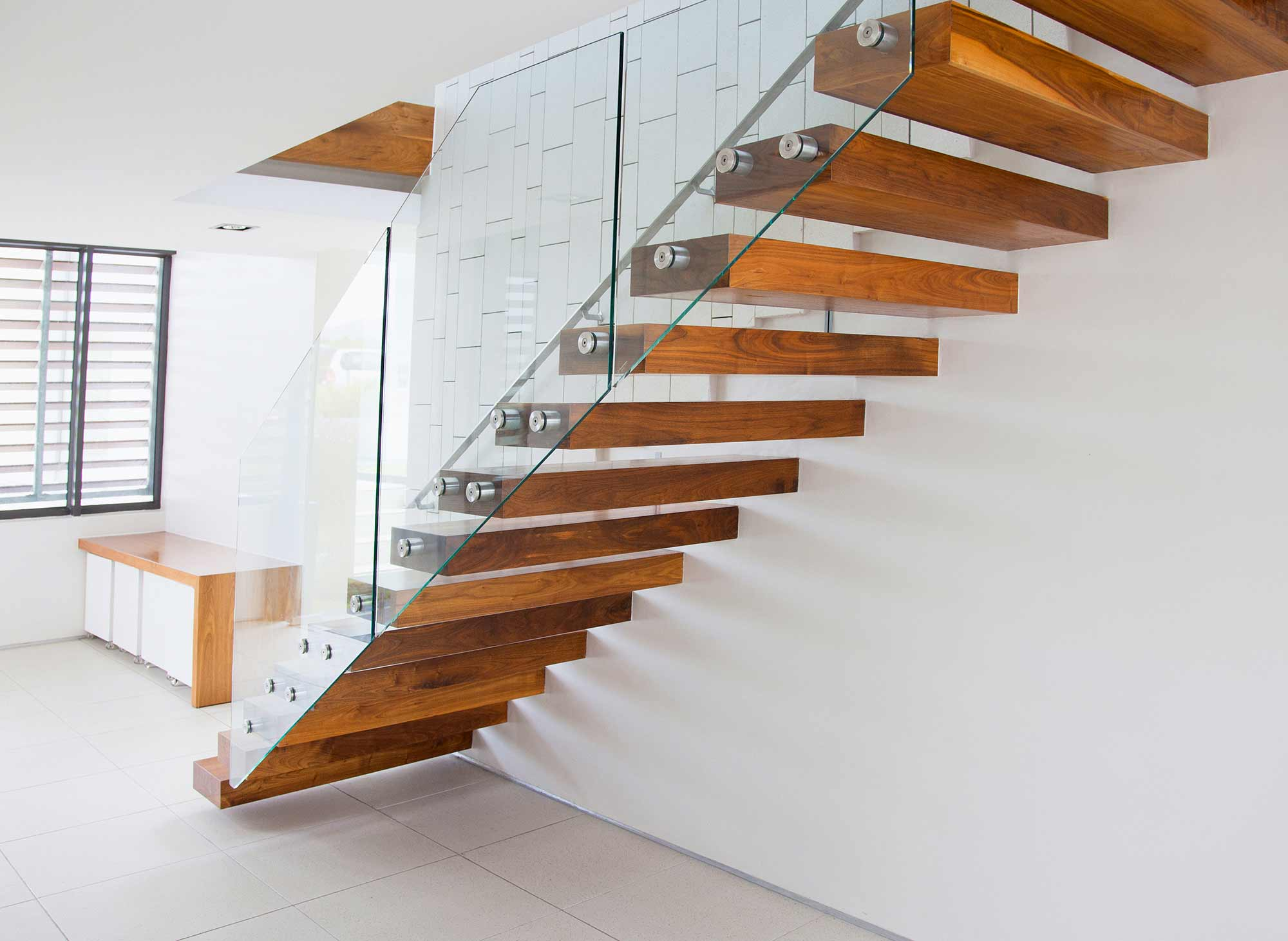 Beautiful Custom Wood Stair Treads Handcrafted in Pennsylvania with Metal Bolts and a Glass Railing