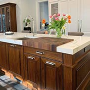 Kitchen Island Butcherblock Surrounded by a Marble Countertop for a Traditional Kitchen in Newton, MA