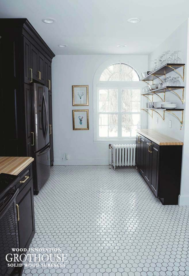 Ash Wood Kitchen Countertops with Black Kitchen Cabinetry, White Tile Flooring and Brass Hardware and Fixtures