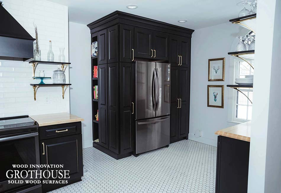 Ash Wood Kitchen Countertops with Custom Black Cabinetry, Custom Shelving, White Flooring and Brass Accents