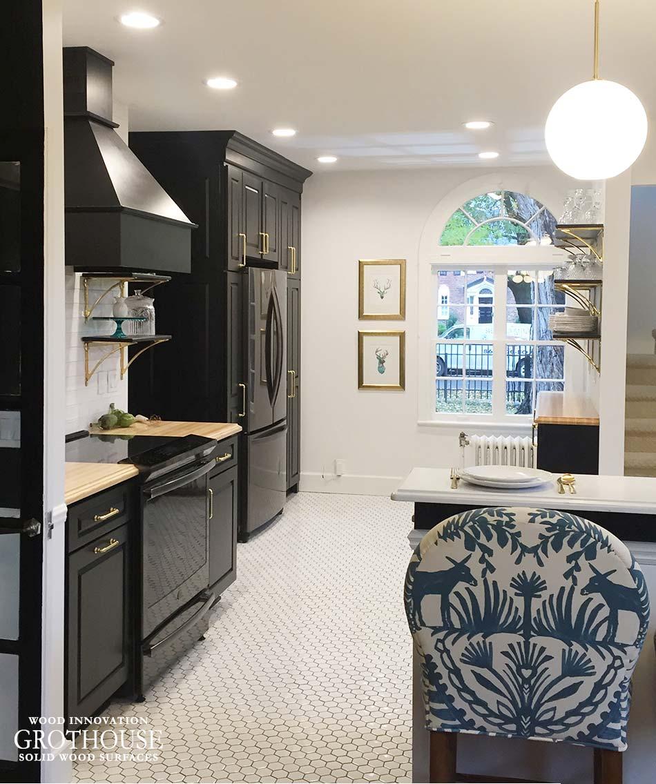 Ash Wood Kitchen Countertops Surrounding a Cooking Range with a Custom Rangehood in Royal Oak, MI