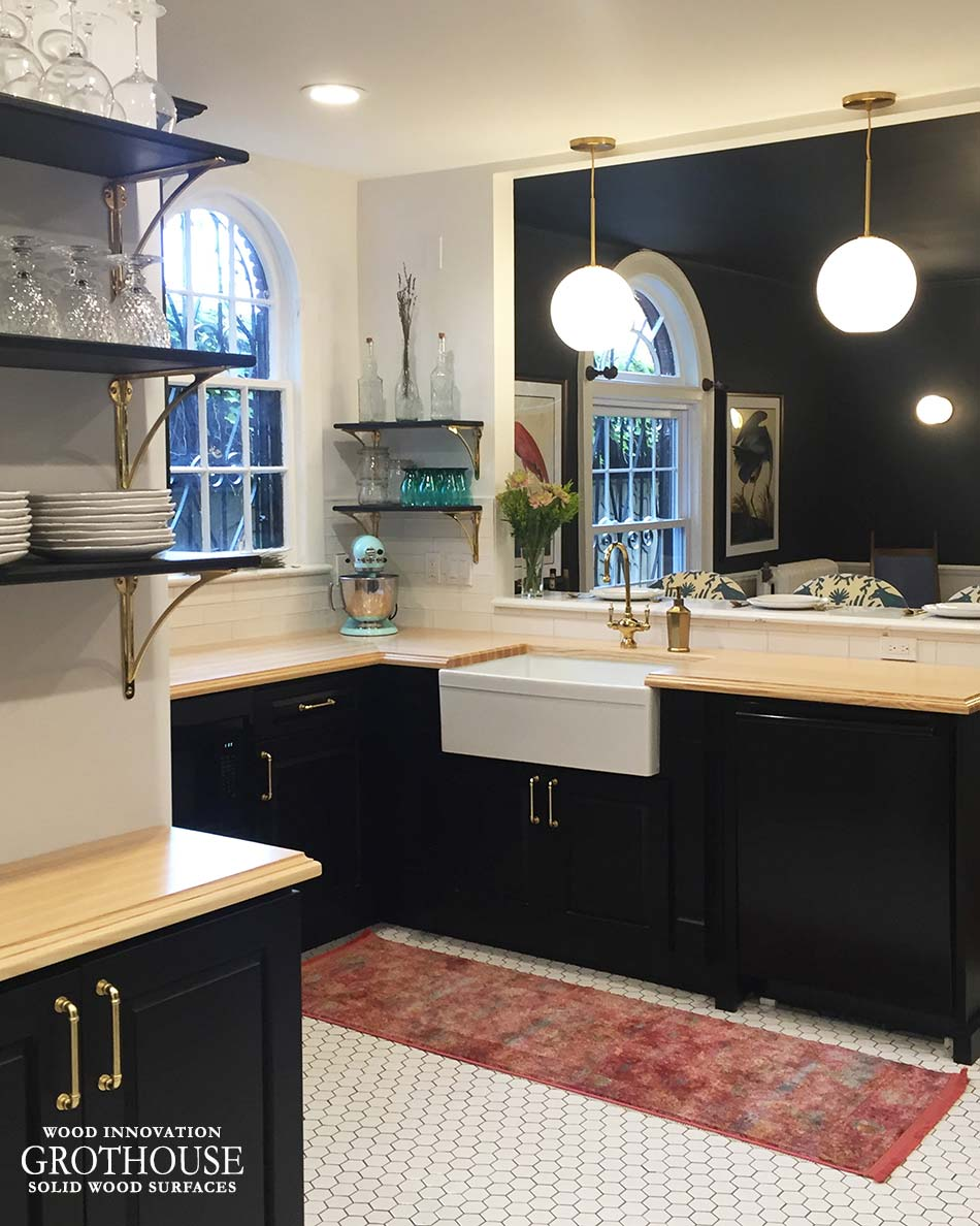 Ash Wood Kitchen Countertops with a White Farmhouse Sink in a Traditional Kitchen Design