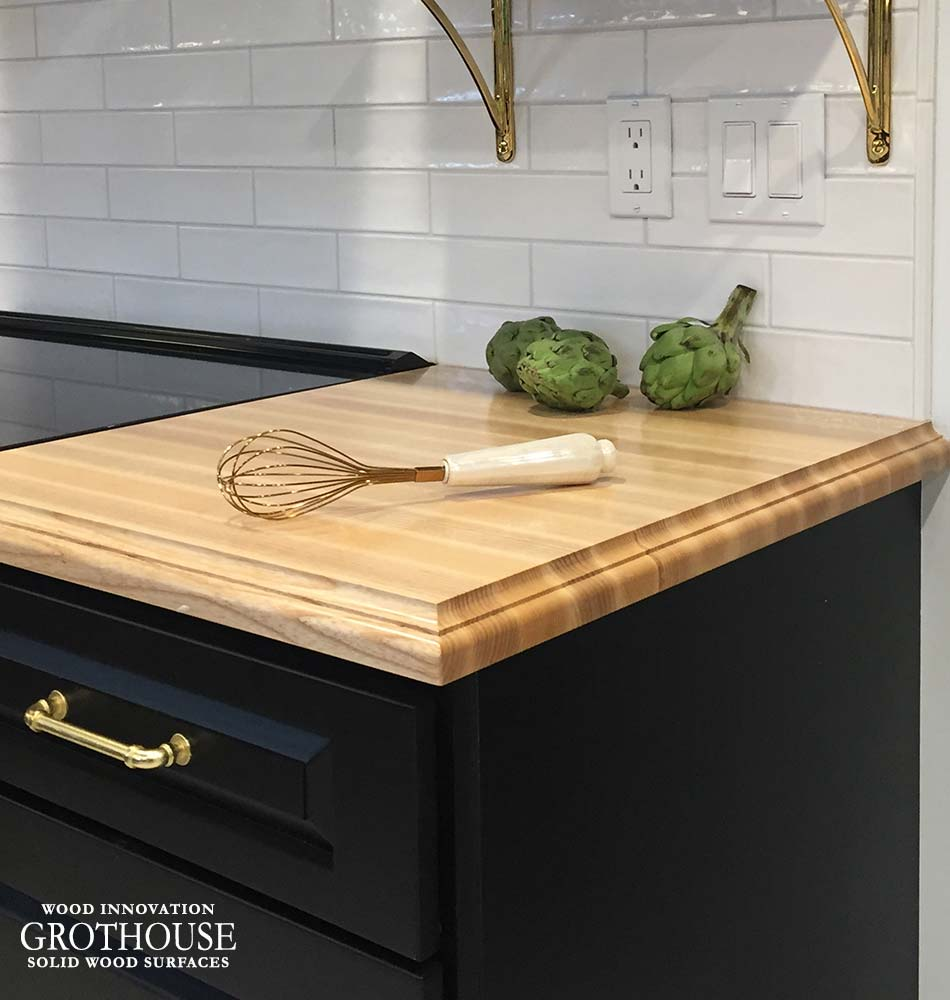 Ash Wood Kitchen Countertops Create Counterspace for Cooking and Baking Preparation Near the Oven and Stove