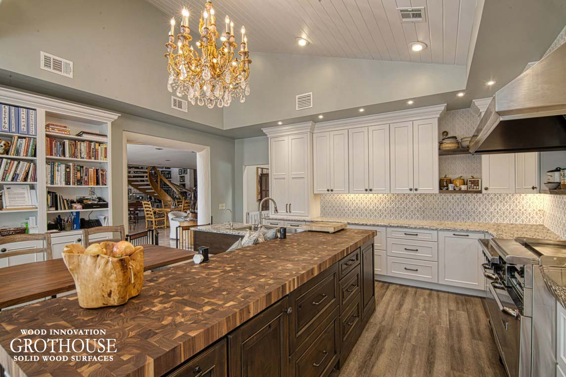 Large Kitchen Island Butcher Block Complemented with White Kitchen Cabinetry in Port St. Lucie, Florida