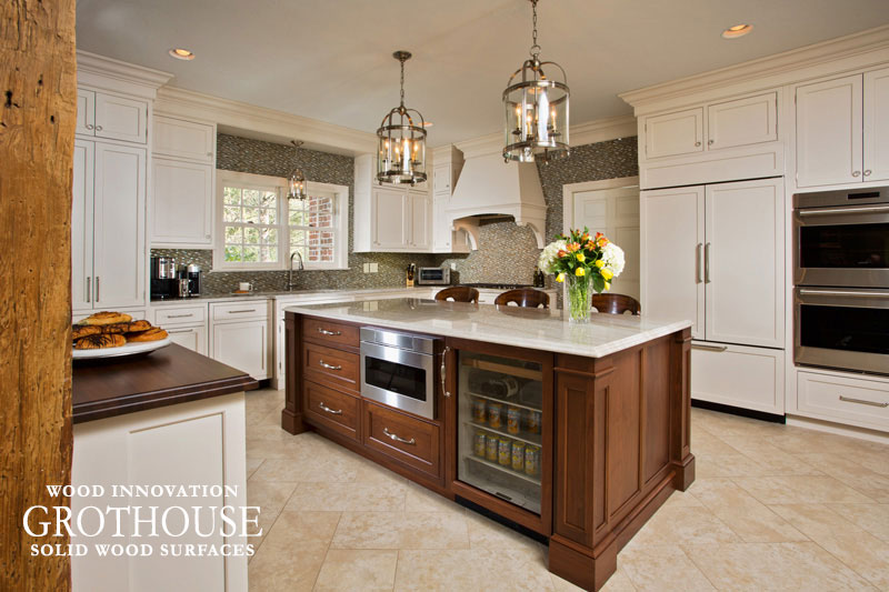 Large Kitchen with a Walnut Sapwood Kitchen Countertop and Surrounding Taj Mahal Quartzite Countertops