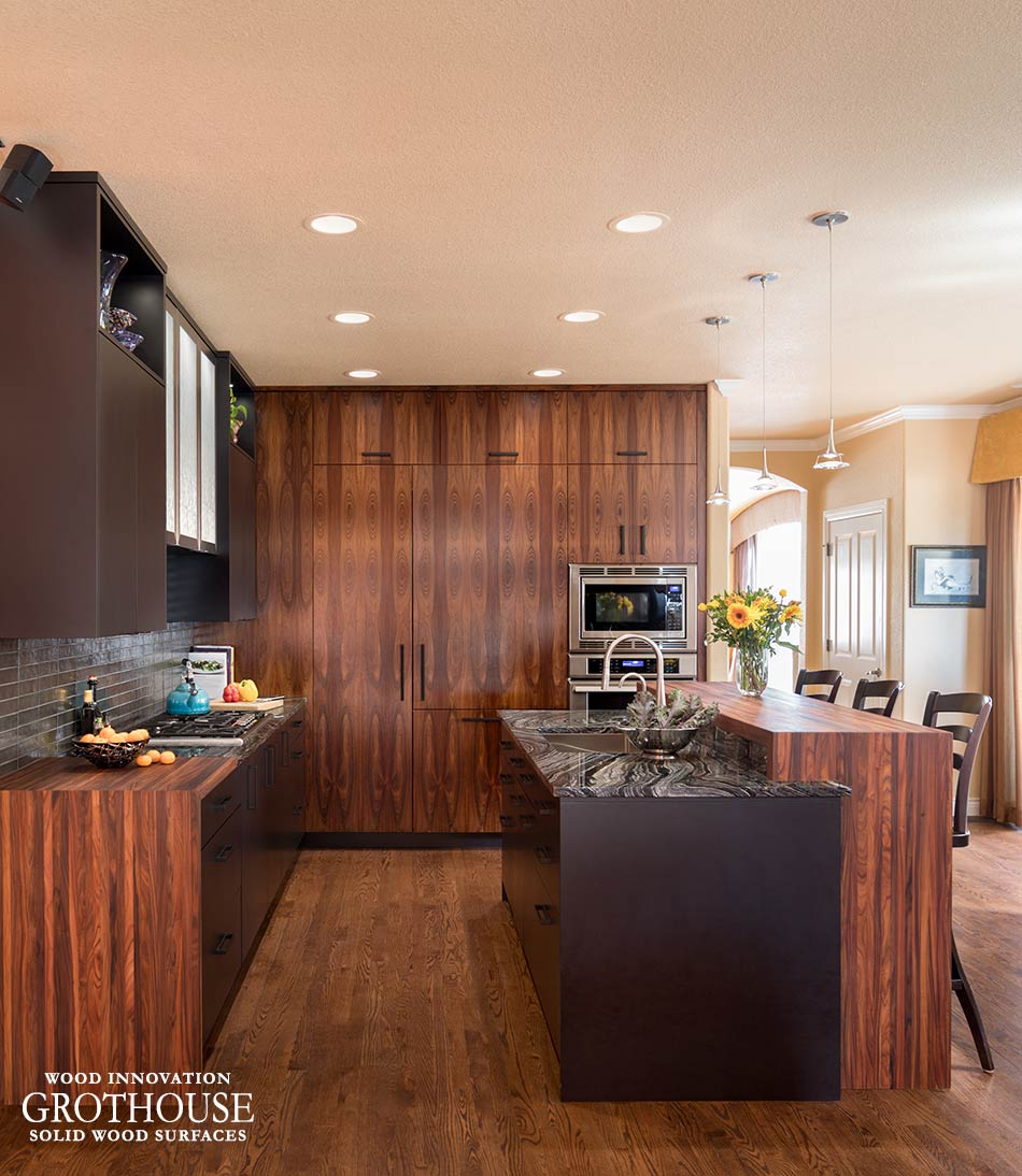 Bolivian Rosewood Countertops with Ceiling High Brown Cabinetry in a Contemporary Kitchen Design in Denver, CO