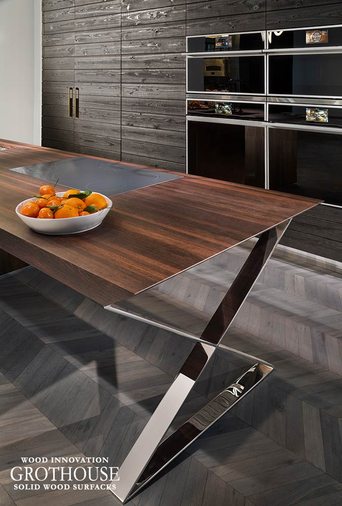 Wenge Wood Countertop with a Monogram Appliances Cooktop for a booth at KBIS 2019 in Las Vegas