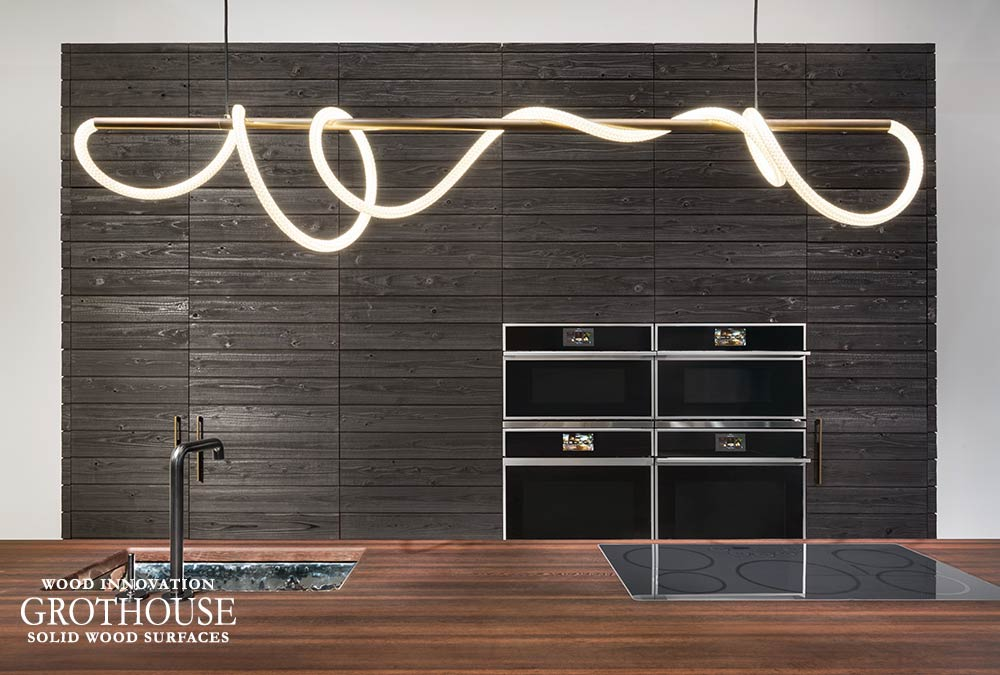 Wenge Wood Countertop with Dark Gray Cabinetry for the Monogram Appliances Booth at KBIS 2019