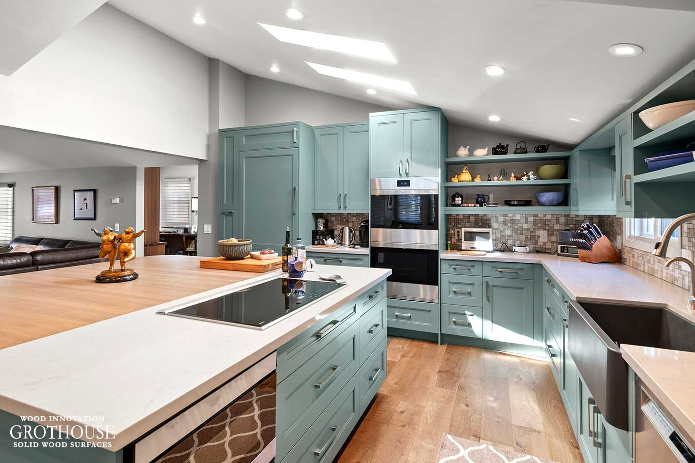 Contemporary Kitchen Design with Caesarstone Engineered Quartz Perimeter Countertops and an Ash Wood Kitchen Island Top