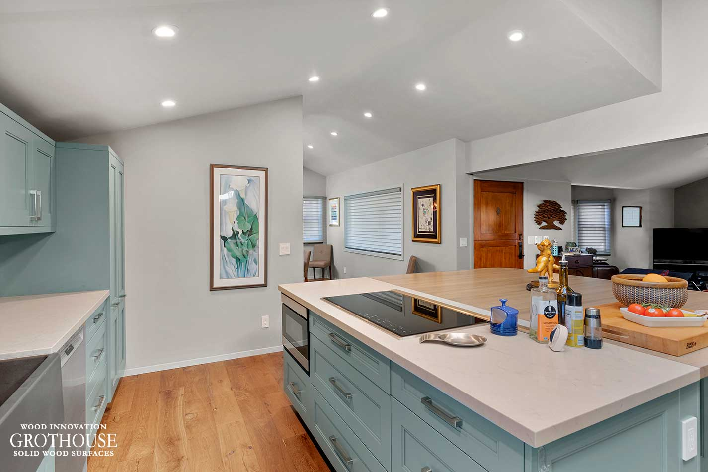 Contemporary Kitchen with a Large Ash Wood Kitchen Island with Soft Teal Cabinetry in Seaside, California