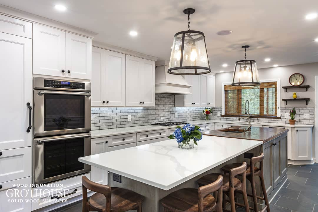 Reclaimed Chestnut Countertop Surrounded by White Countertops in a Rustic Kitchen Design in Pittsburgh Pennsylvania