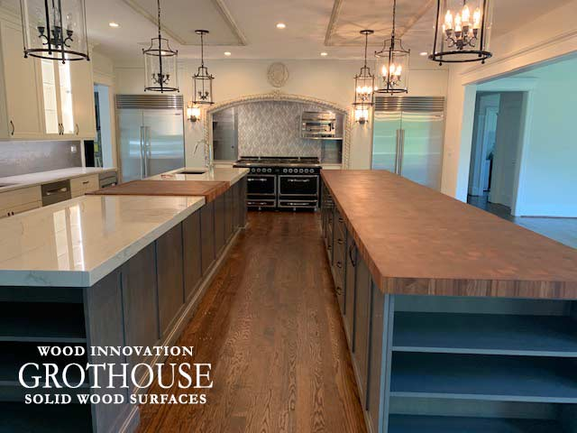 Large Butcher Block Island Countertop with White Countertops in a Transitional Kitchen Design in Gladwyn, PA