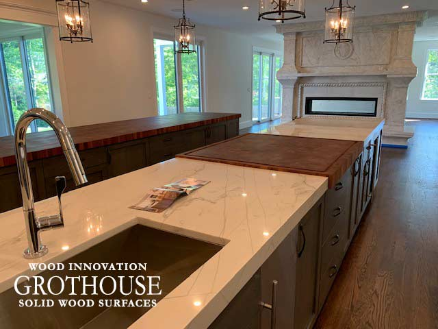 White Marble Countertop with a Large Butcher Block Island Countertop in a Transitional Kitchen in PA