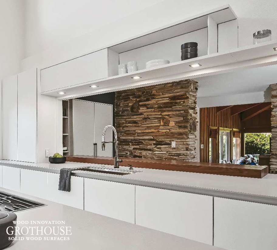 Beautiful White Contemporary Kitchen Design with a Walnut Wood Waterfall Table in Longwood, Florida