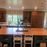 Alder Wood Kitchen Island Countertop in a Traditional Kitchen Designed by Worthington Fine Woodwork in Newtown, PA