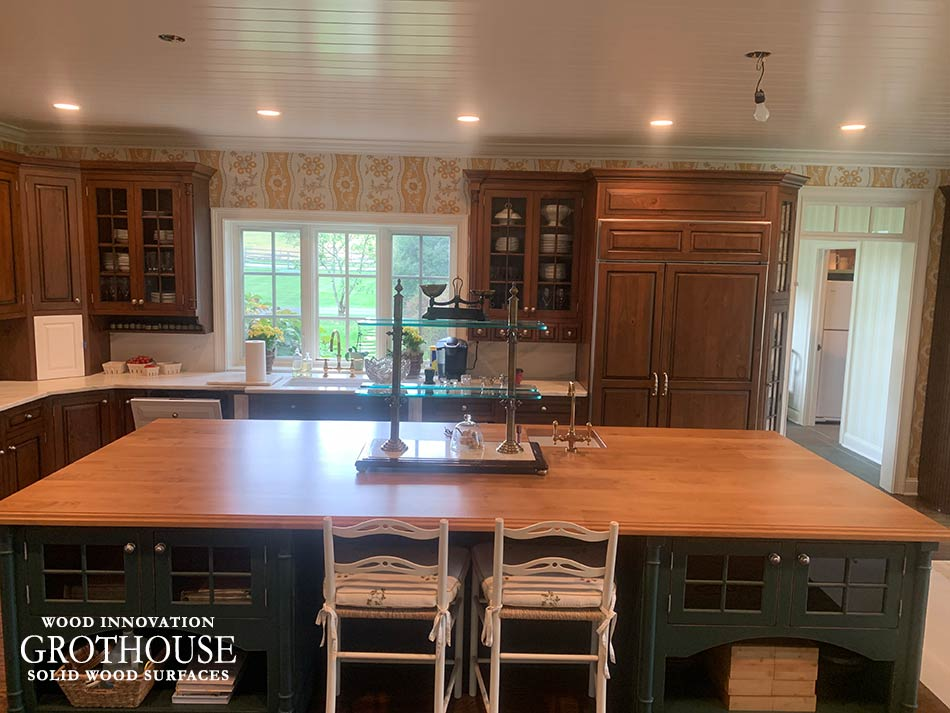 Alder Wood Kitchen Island Countertop in a Traditional Kitchen Designed by Worthington Fine Woodwork in Newtown, PA