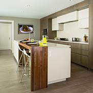 White Kitchen with a Walnut Waterfall Island Table Crafted by Grothouse in Roslyn New York