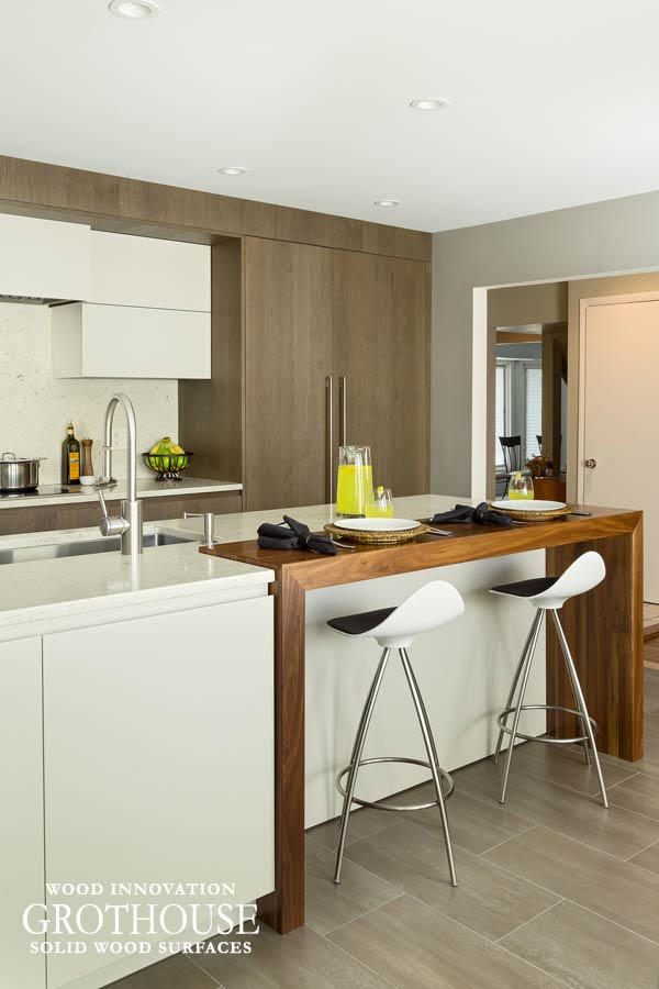 Walnut Waterfall Island Table with White Cabinetry and White Countertops in Roslyn, New York