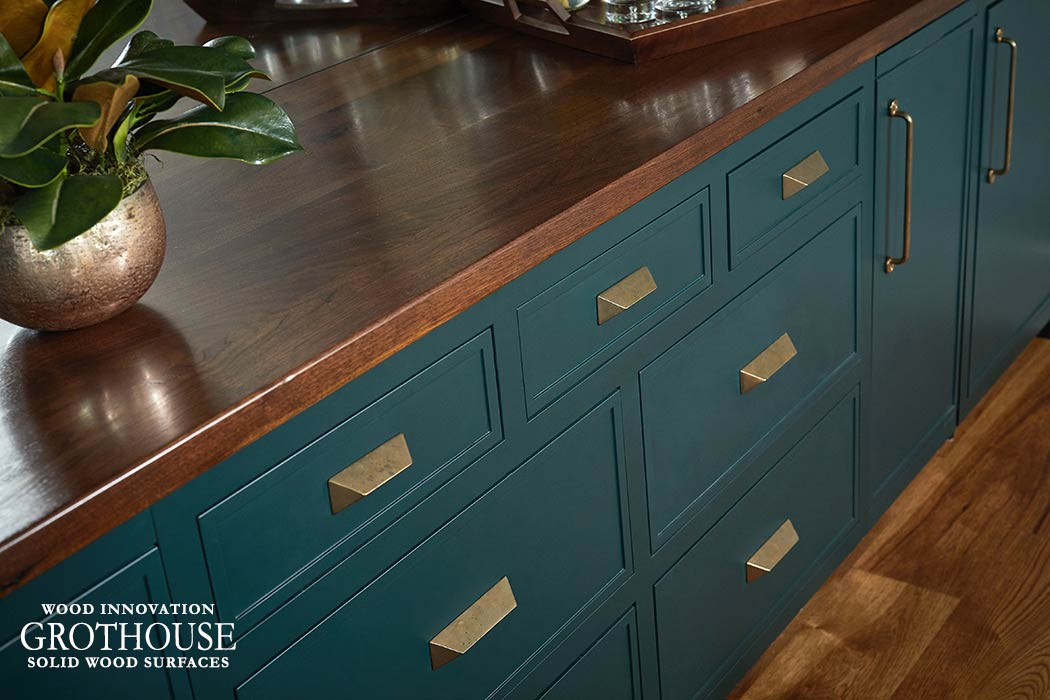 Walnut Dining Room Countertop with Blue Cabinetry and Gold Hardware