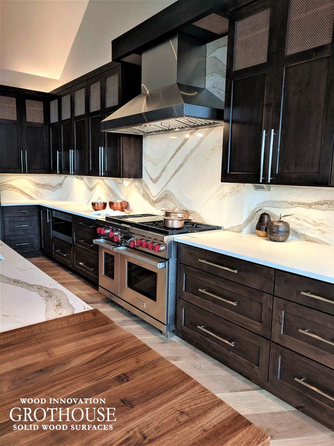 Contemporary Kitchen in Frisco, Colorado features banquette seating and a Walnut Kitchen Island Countertop