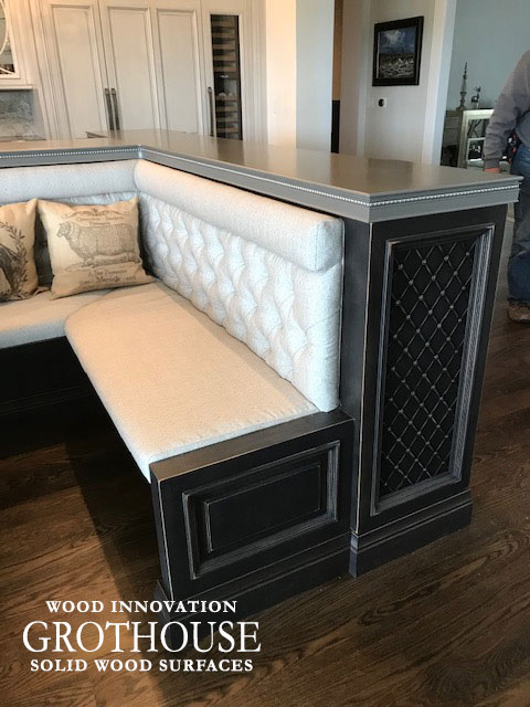 Kitchen Island with Banquette Seating and a Metal Bar Top in Denver, Colorado