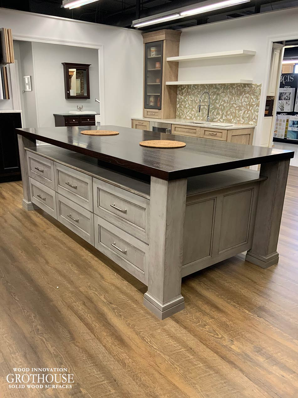 Stained Ash Wood Countertop Display with Gray Cabinetry for Majestic Kitchens & Bath in Mamaroneck, New York