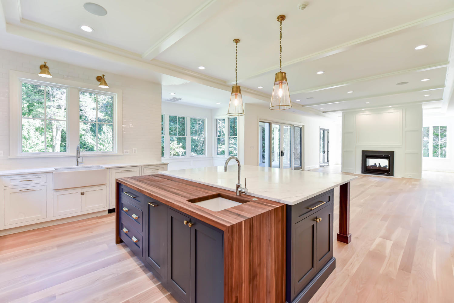 Traditional Kitchen Design with a Walnut Waterfall Countertop and White Perimeter Cabinetry Located in McLean, Virginia