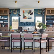 Knotty Alder Wood Island Surround with Anvil Metal Accents and Waterfall Legs for House Beautiful Whole Home 2020