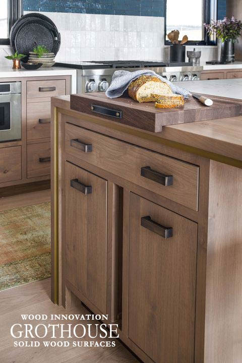 Saxon Wood Cutting Board with Leather Handle and Drop Lip Front Edge in House Beautiful Whole Home 2020